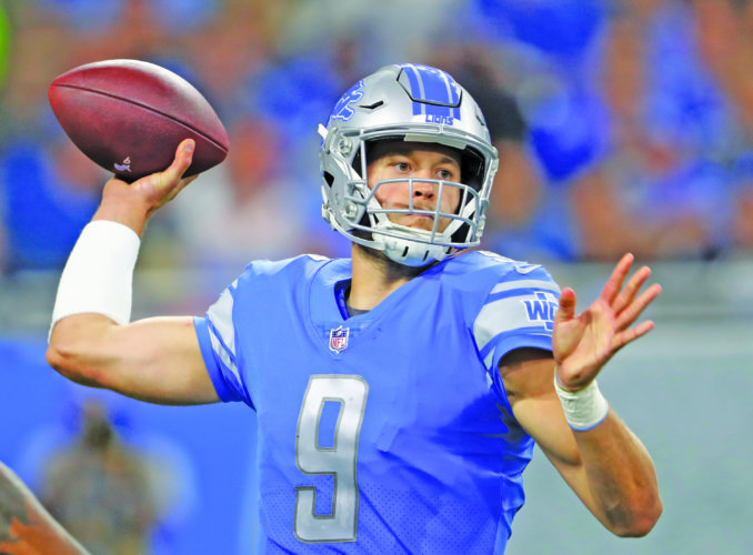 FILE - In this Oct. 8, 2017, file photo, Detroit Lions quarterback Matthew Stafford throws against the Carolina Panthers during an NFL football game in Detroit. DetroitÕs passing game looks poised to take off during the second half of this season, but there are some factors beyond the LionsÕ controlÐsuch as the elements. The forecast calls for clear conditions Sunday when Detroit plays at Chicago, but Stafford can never be too sure about that when on the road against the Bears. (AP Photo/Paul Sancya, File)