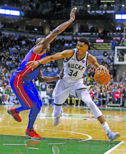 Milwaukee Bucks' Giannis Antetokounmpo (34) drives to the basket against Detroit Pistons' Anthony Tolliver during the second half of an NBA basketball game Wednesday, Nov. 15, 2017, in Milwaukee. The Bucks won 99-95. (AP Photo/Aaron Gash)
