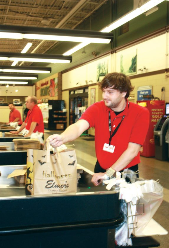 Jenny Lancour | Daily Press Kenneth Peterson, of Escanaba, bags groceries recently for a customer at Elmer's County Market in Escanaba. Peterson was hired to work at the local grocery store through a partnership between Elmer's and Lakestate Industries that offers people with disabilities an opportunity to be employed in the community.