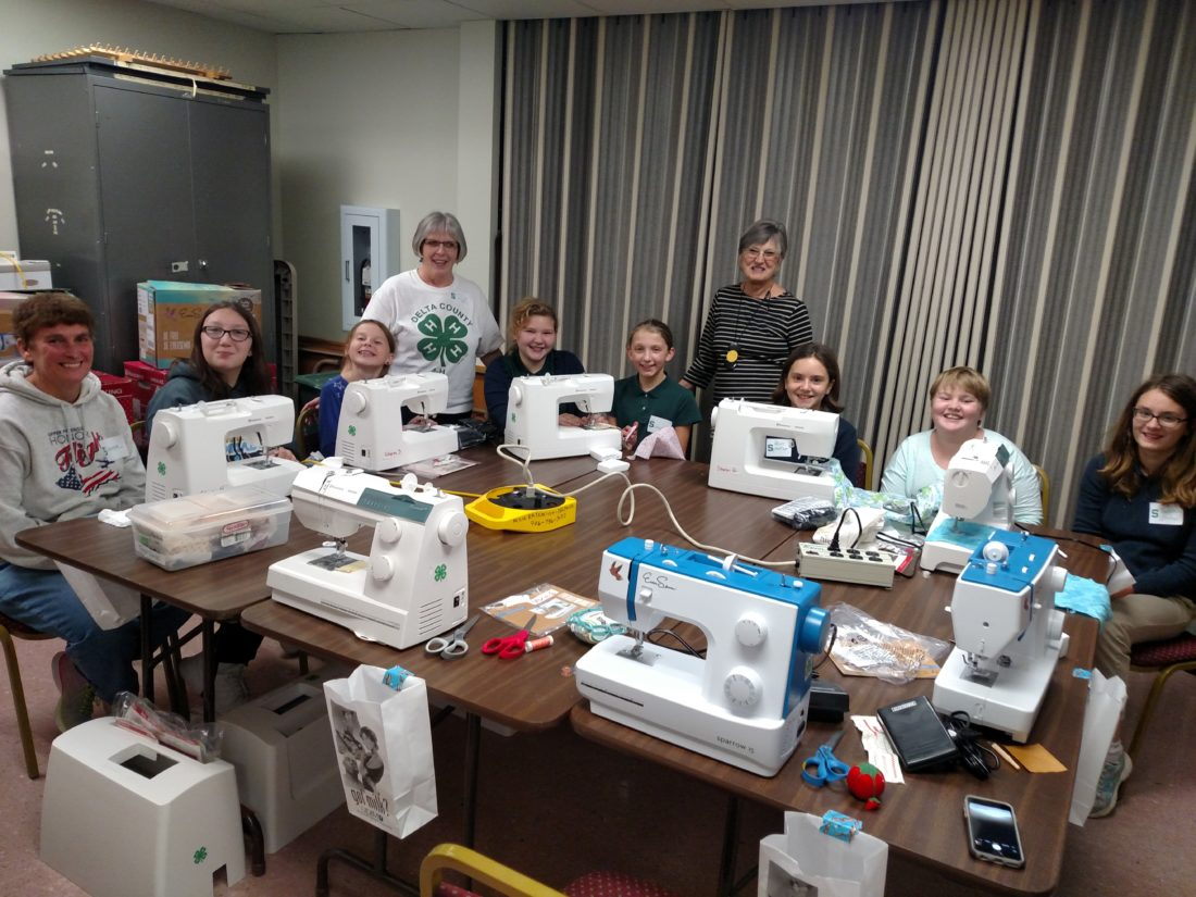 Courtesy photo Members of the Sewing Up A Storm 4-H SPIN pose for a picture with their six new sewing machines purchased with a grant from the Dagenais Foundation. Jeanine Dagenais, of the foundation, was on hand to see the new machines in action. Shown are, from left, Donna Otradovec, Gracelyn Wiles, Stella Gross, Ruth Botbyl, Libby Spreitzer, Samantha Korpi, Jeanine Dagenais, Natalie Spreitzer, Alona Hawkins, and Veronica Spreitzer.