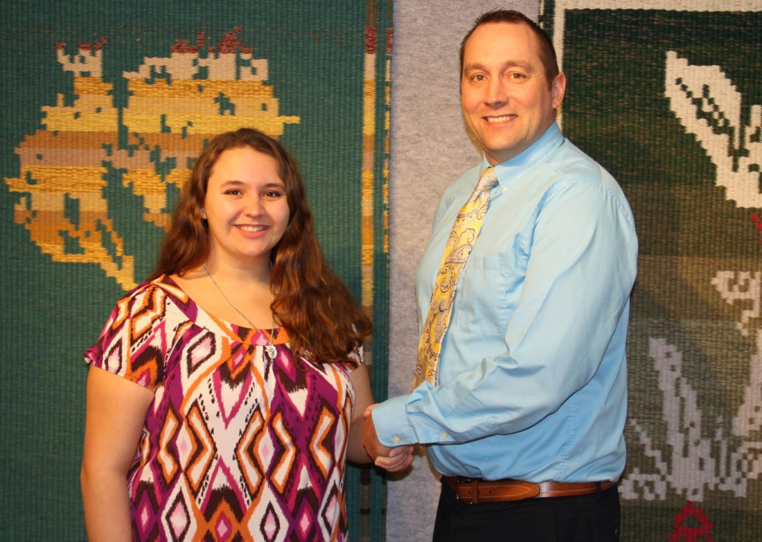 Courtesy photo Kevin Carlson, vice president of finance, training and development at Bay College, congratulates Bay College student Sarah Starzynski, of Stephenson. Starzynski was a recipient of the Bay College Board Scholarship for Academic Year 2017-18. The Bay College Board Scholarship is awarded each year to 10 high achieving high school seniors attending Bay College.