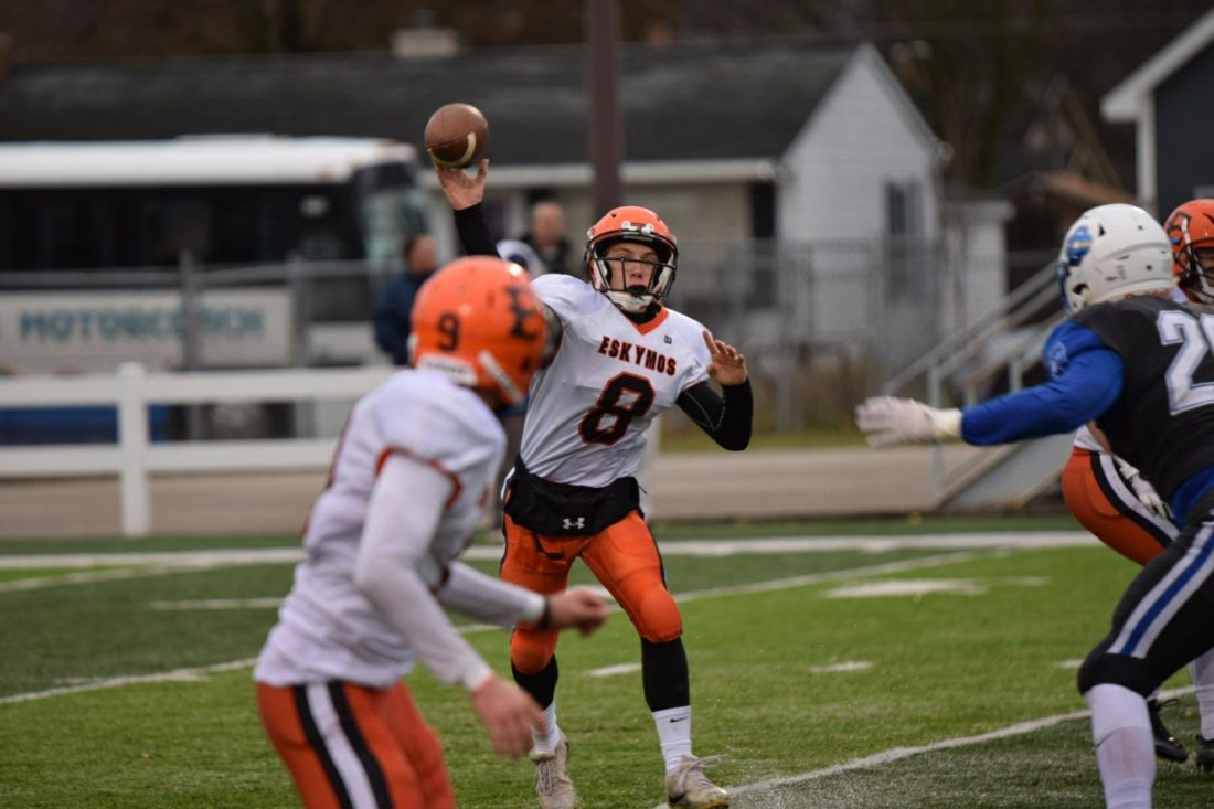 Courtesy photo Anne Truitt Escanaba quarterback Craig Kamin (8) throws a pass to Hayden Haslow in Saturday's Division 4 state semifinal game in Traverse City.
