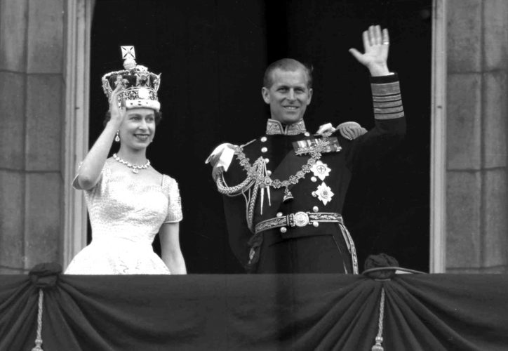 This is a June. 2, 1953 file photo of Britain's Queen Elizabeth II and Prince Philip, Duke of Edinburgh, as they wave to supporters from the balcony at Buckingham Palace, following her coronation at Westminster Abbey. London. (AP Photo/Leslie Priest, File)