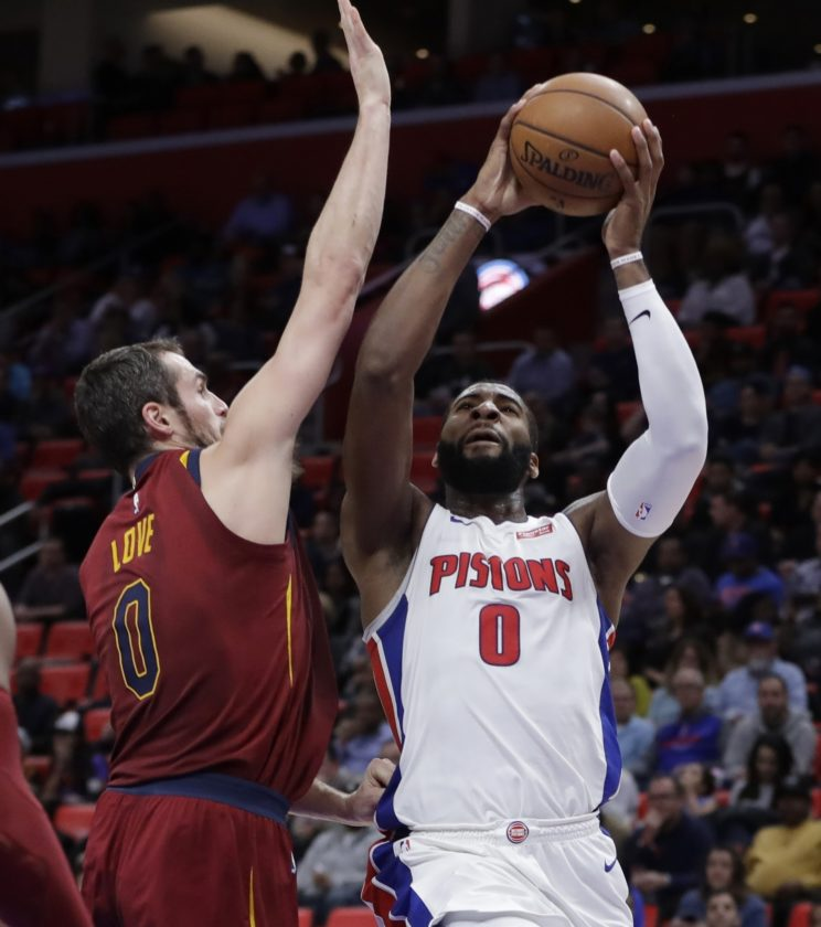 AP photo Detroit Pistons center Andre Drummond (0) shoots as Cleveland Cavaliers forward Kevin Love (0) defends during the first half Monday in Detroit.