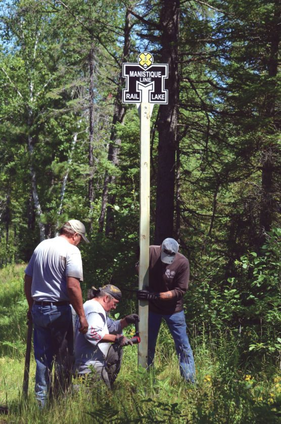 DNR photo Michigan's first rail trail, established in the Central Upper Peninsula in 1970, now features innovative mile markers that combine function and historical references.