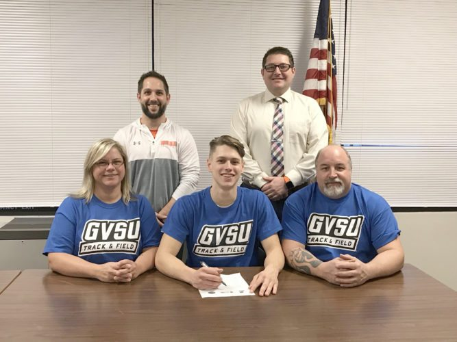 Courtesy photo Mid Peninsula's Terry Brower signed a national letter of intent Monday to attend Grand Valley State University and compete for the men's track and field team in high jump. Seated with Brower are his mom Karin and dad Todd. Also pictured are Principal/Athletic Director and Coach Bobby Reichel (back left), and Superintendent Eric VanDamme (back right).