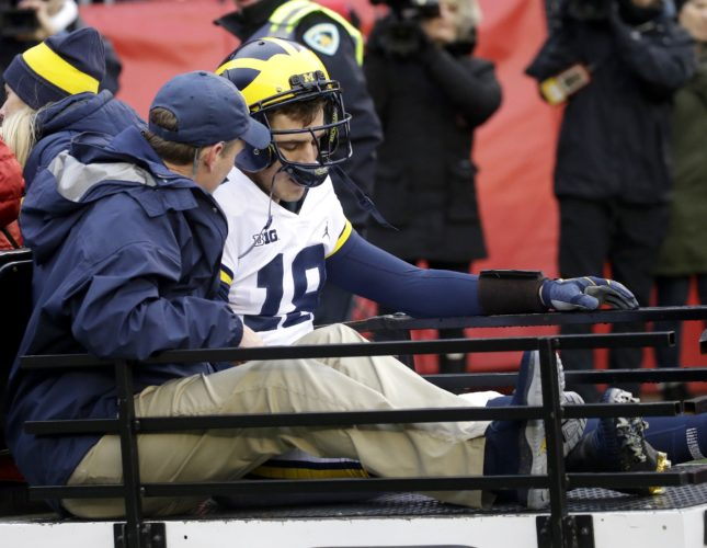 AP photo Michigan's Brandon Peters is carted off the field after being injured during a game against Wisconsin Saturday in Madison.