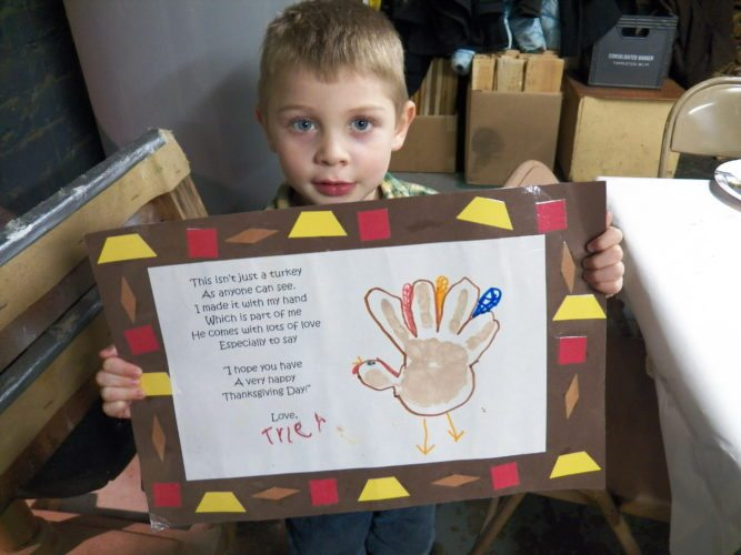 "Karen Wils Tyler with his  ""turkey time"" keepsake."