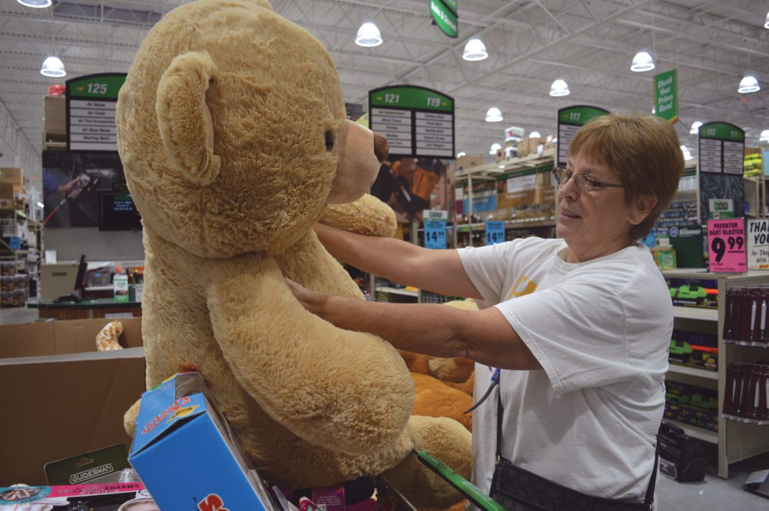 Jordan Beck | Daily Press Bark River resident Mary French thinks about buying a large teddy bear at the Menards store in Escanaba earlier this morning.