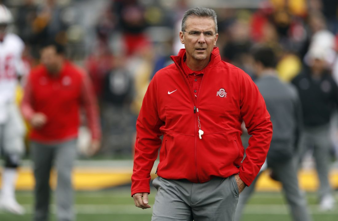 Ohio State coach Urban Meyer walks on the field before the team's game against Iowa in Iowa City.