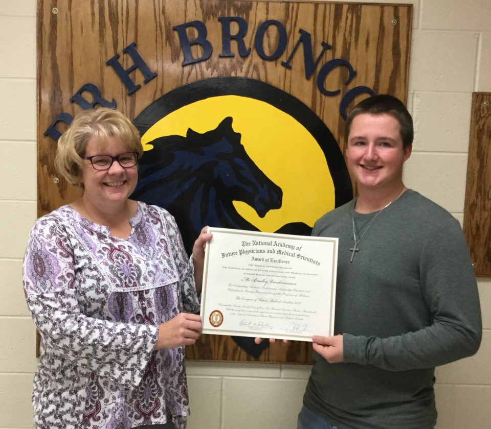 Courtesy photoMrs. Nancy Prica, science teacher at Bark River-Harris School and Bradley Vandermissen hold the award of excellence the National Academy of Future Physicians and Medical Scientists bestowed upon Vandermissen.