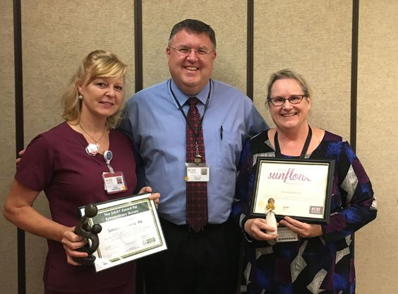 Courtesy photo OSF HealthCare St. Francis Hospital & Medical Group has awarded its first two honorees for the new Thank a Caregiver program. Shown are, from left, Sandra Thomma, RN; Dave Lord, president of OSF HealthCare St. Francis Hospital & Medical Group and Brenda Nelson.
