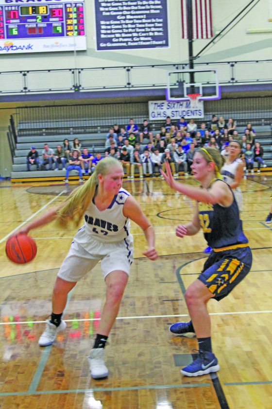 Avery Bundgaard | Daily Press Gladstone's Megan Crow (42) puts a move on Negaunee's Allyson Jacobson Tuesday at Gladstone.