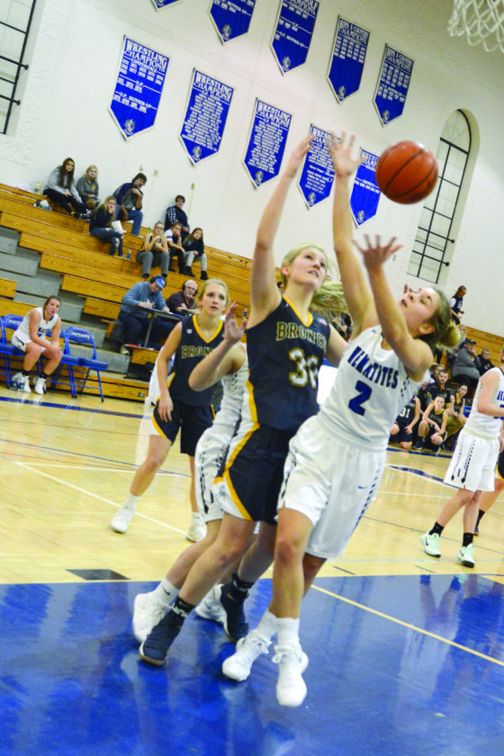 Journal photo by Corey Kelly Bark River-Harris' Lauryn Bloniarz and Ishpeming's Mariah Austin go for the ball during a game Tuesday night at Ishpeming High School.