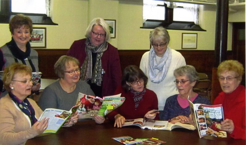 Courtesy photos Above, the ladies of First United Methodist Church in Escanaba look over cookie recipes. Pictured in the front row from left are Jean LaPlante, Ann Tembreaul, Mary Nyberg, Judy Leinberger, and Dorothy Pepin. In back from left are Lila Apsey, Lu Malmsten, and Norma Yoder.