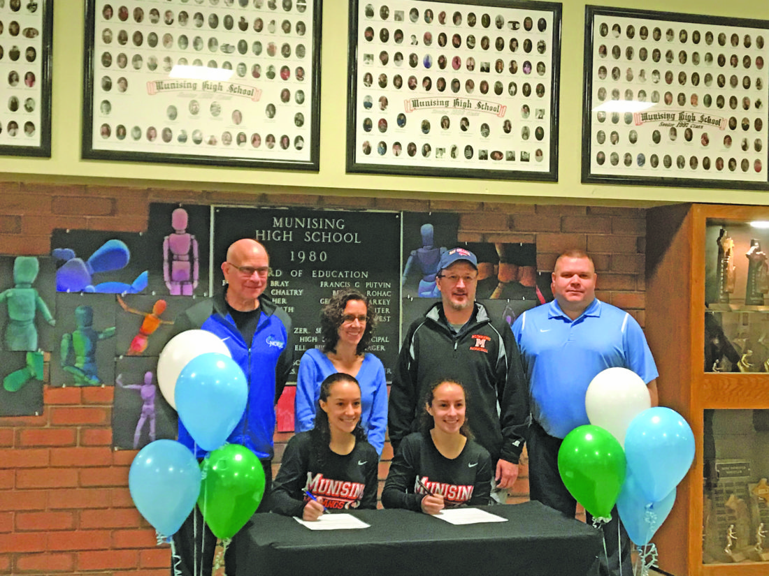 Courtesy photo Munising's Kelsea and Marisa Ackerman signed a national letter of intent Wednesday to attend Bay College and play basketball for the Norse. Pictured at Wednesday's signing seated in front from left are: Kelsea and Marissa Ackerman. In back from left are: Bay College coach Rae Drake Jr., Paula and Joe Ackerman and Munising coach Matt Mattson.