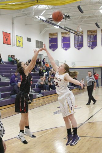 Avery Bundgaard | Daily Press North Central's Jadie Linder (left) gets a shot off over Rapid RIver's Kristin Goodacre during the first quarter Friday at Rapid River.