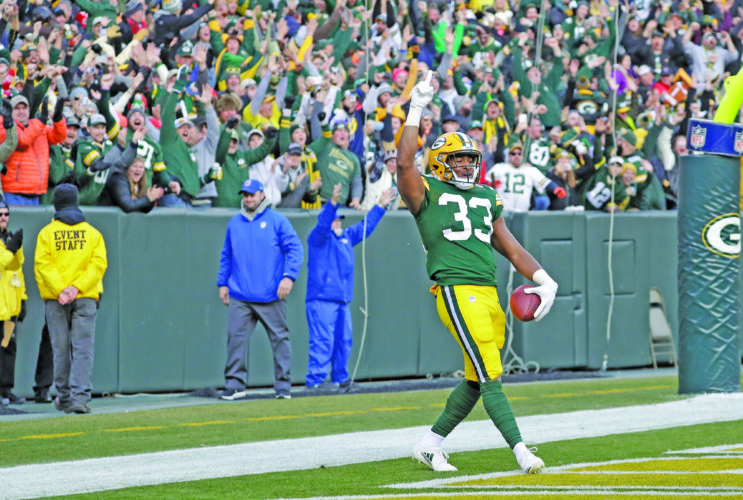 AP photo Green Bay's Aaron Jones celebrates his touchdown run Sunday  in overtime, giving the Packers a 26-20 win against Tampa Bay at Lambeau Field.