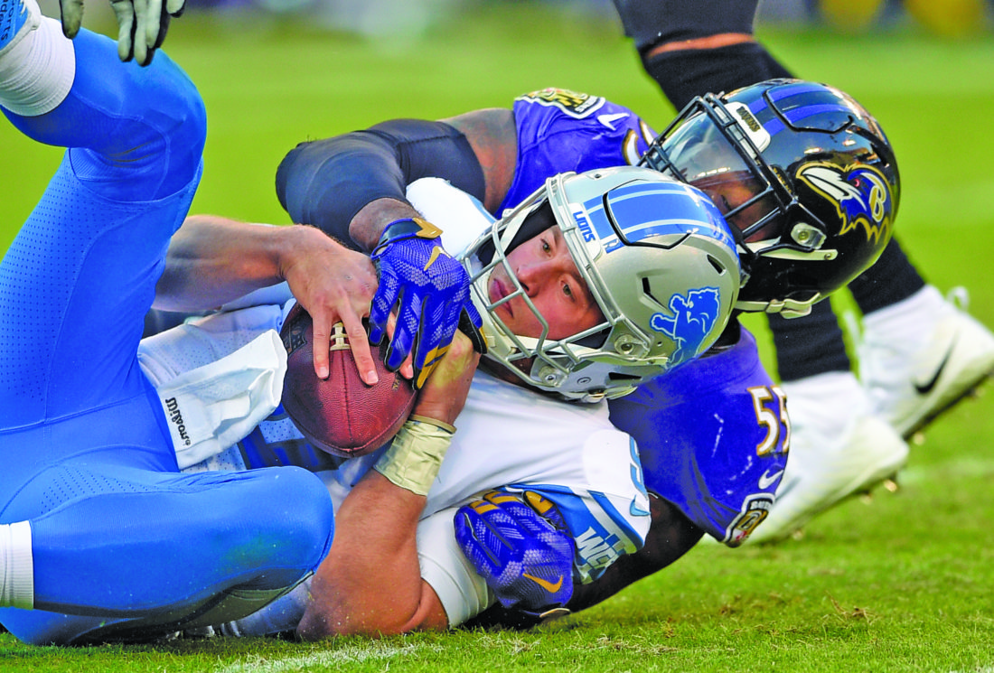 AP photo Detroit quarterback Matthew Stafford is sacked by Baltimore  linebacker Terrell Suggs in the second half Sunday. Stafford completed a team-record 20 straight passes and left late in the fourth quarter with a bruised right hand.