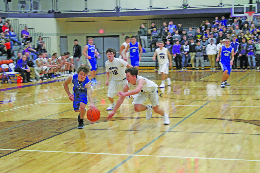 Avery Bundgaard   Daily Press Gladstone's Quinn Downey (right) and Ishpeming's Gavin Sundberg (left) battle for a loose ball while Gladstone's Carson Shea (12) looks on during the third quarter Tuesday at Gladstone.