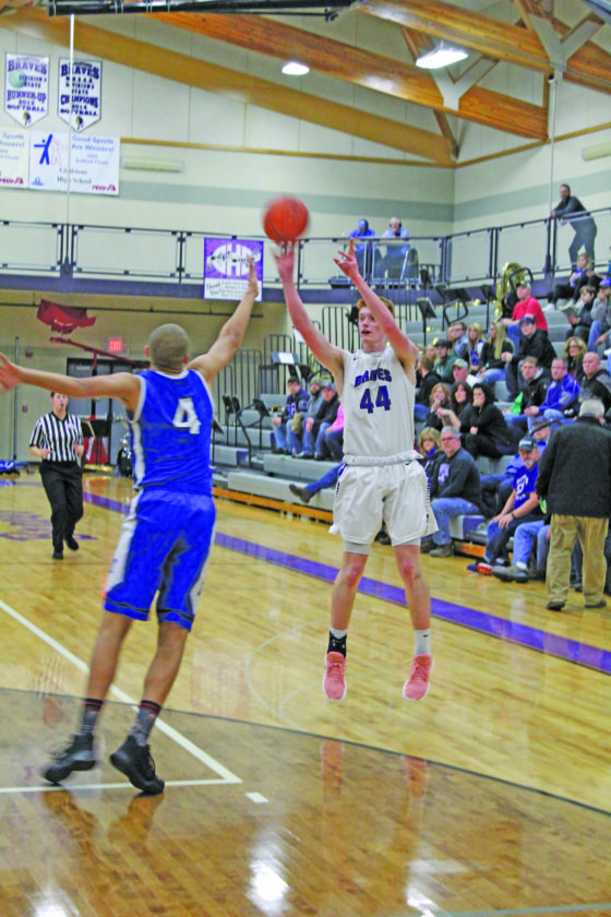 Avery Bundgaard   Daily Press Gladstone's Reece Castor (44) puts up a 3-point shot over Ishpeming's Dondre Yohe (4) during the second quarter Tuesday at Gladstone.