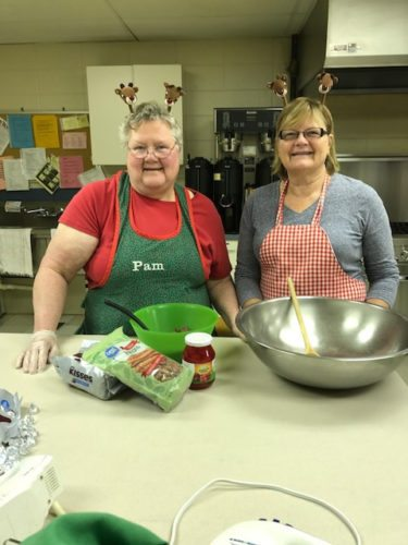 Courtesy Photos Reindeer bakers Pam Thorbahn and Jan Johnson make cookies in Memorial Church's kitchen for the Saturday bake sale.