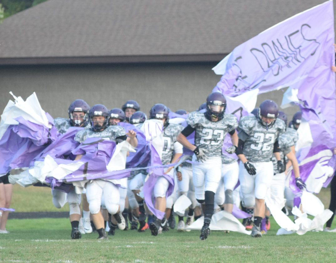 Mike Mattson | Daily Press The Gladstone football team bursts through its banner as it takes the field before a game against Westwood during this past season.