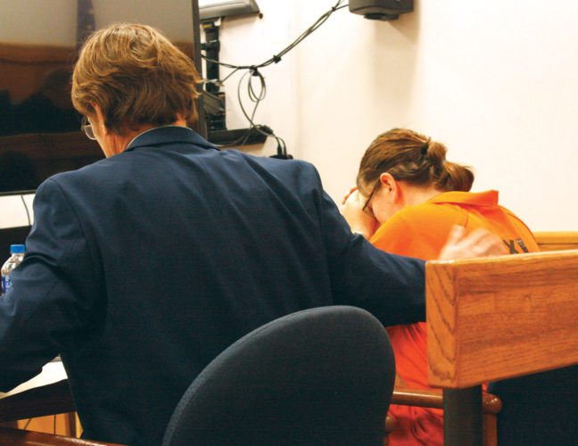 Jenny Lancour | Daily Press Attorney Everette Ayers III consoles his client, Michaela Denise Maupin, 29, of Gladstone, as she rests her head in her hands Thursday while testimony is presented in Delta County District Court regarding the drowning death of her 15-month-old daughter, Melina. Maupin is charged with second-degree murder, a life felony.