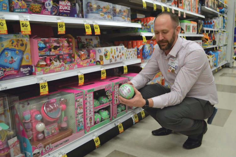 "Haley Gustafson | Daily Press  Escanaba Meijer Store Manager, Jeff Kietzman, shows what is arguably one of the hottest toys of the season, ""L.O.L. Surprise Tots Dolls"" at the store Tuesday. According to Kietzman, the dolls are one of the hardest things to keep on Meijer's shelves."