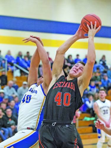 Adam Niemi |Iron Mountain Daily News  Escanaba's Jared Nash (40) grabs a rebound against Kingsford on Friday in Kingsford.