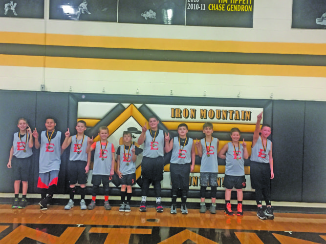 Courtesy photo The Escanaba fifth grade junior hoopsters recently won the Iron Mountain Tournament. The squad beat Iron Mountain 38-21, Ishpeming Hot Shots 39-9 and Negaunee twice,  31-25 and  36-16. The team is coached by Tom Gardner and Jeremy Peacock. Members of the team from left are: Brayden Jupe, Javon Stevenson, John Dittrich, Conner Howes, Brandon Gardner, Cody Noel, Andrew Lord, Lennox Peacock, Nick Garcia and Alex Morgan.