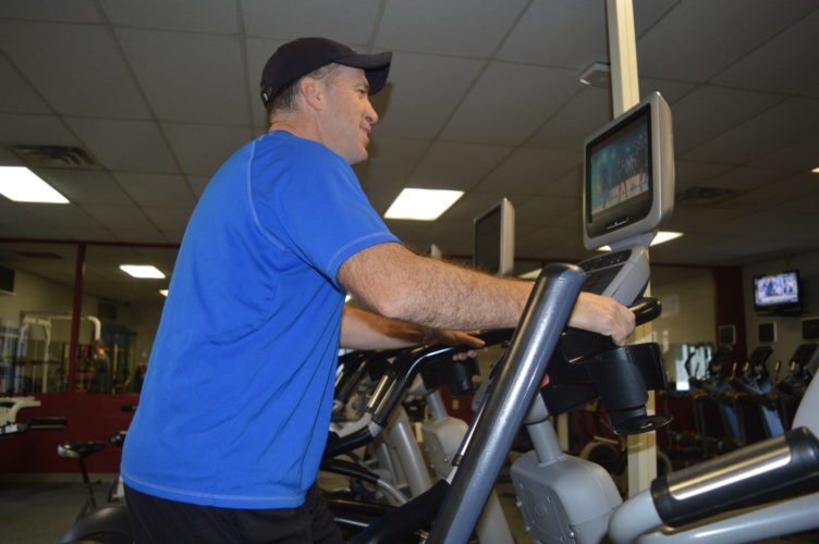 Jordan Beck | Daily Press Gladstone resident Rusty Aird gets some exercise on an elliptical trainer at the Northern Lights YMCA Delta Program Center. Health and Wellness Coordinator Amy Fudala said people can be both happy and healthy during the holidays by taking a few simple steps.
