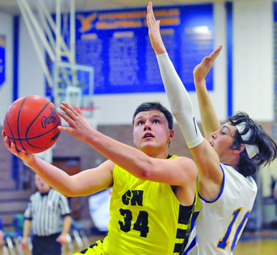 Jody Korch | Marinette EagleHerald Carney-Nadeau's Jason Kirschner drives to the basket while being defended by Stephenson's Merlin Thoune in the first half Monday night in Stephenson.