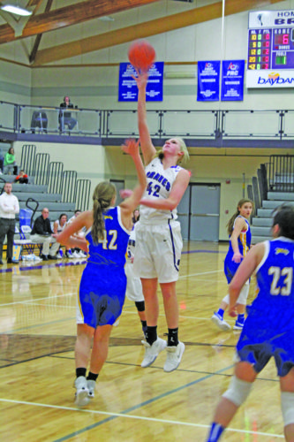 Avery Bundgaard | Daily Press Gladstone's Megan Crow (right) puts up a hook shot over Kingsford's Renee Roberts during the first quarter Tuesday at Gladstone.