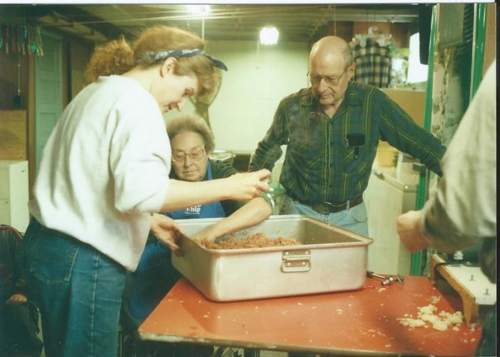 Karen Wils photo Making sausage is a family affair.