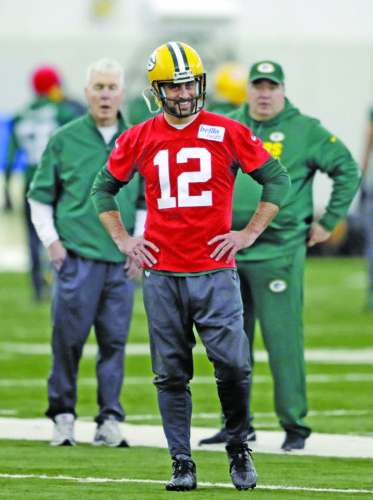 Green Bay Packers quarterback Aaron Rodgers (12) watches during practice at the Don Hutson Center on Wednesday, Dec. 13, 2017 in Ashwaubenon, Wis. (Adam Wesley/The Post-Crescent via AP)