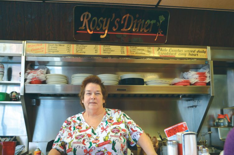 Haley Gustafson | Daily Press  Rosy Cox, owner of Rosy's Diner in downtown Escanaba, takes a break from cooking at the local eatery Tuesday. In October, Rosy's Diner was named number one diner in the state of Michigan on an online blog site.
