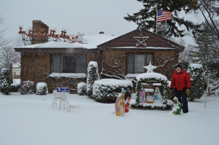 Jordan Beck | Daily Press Escanaba resident John Johnson stands next to some of the decorations set up outside his house on the north side of Escanaba. Johnson said he also puts a considerable amount of work into decorating the inside of his house.