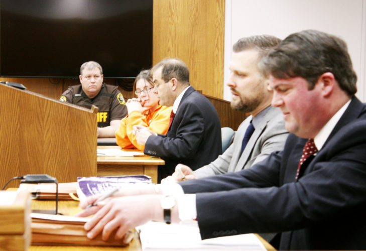 Jenny Lancour | Daily Press Michaela Denise Maupin, 29, of Gladstone, converses with her attorney, Jean-Paul Rudell, third from left, prior to a disposition hearing in Delta County Probate Court resulting in her parental rights being terminated for her two sons Friday morning. Maupin is accused of murder in the Oct. 7 drowning death of her 15-month-old daughter, Melina. Pictured above, from left, are Deputy Jeff Iverson, Maupin, Rudell, County Prosecutor Philip Strom, and John M.A. Bergman, attorney for Maupin's two sons, ages 3 and 8.