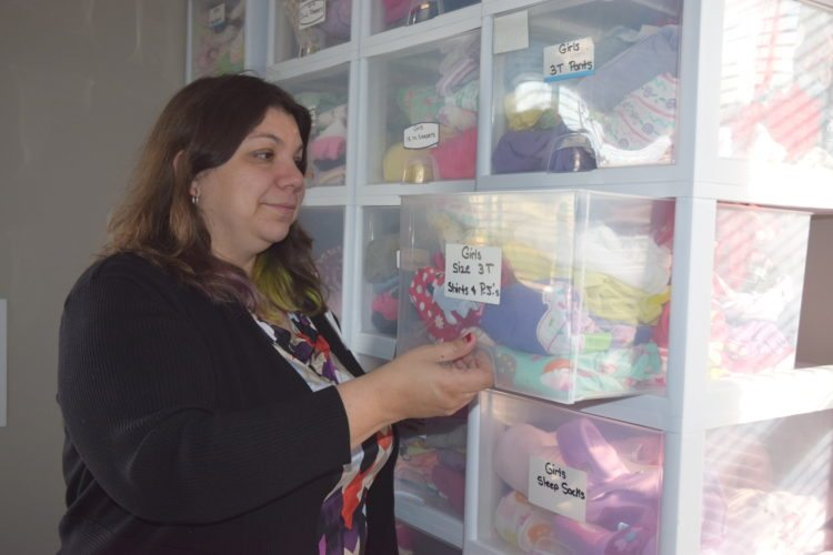 Jordan Beck | Daily Press Pregnancy Services of Delta County Executive Director Audra Buchmiller checks supplies in the organization's resource room.