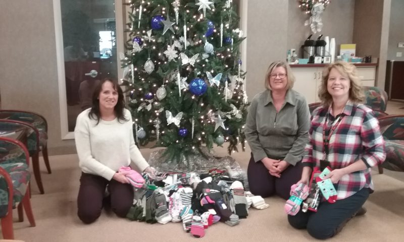 Courtesy photo  First Bank employees set a challenge to see how many pairs of socks could be collected during a few days this holiday season. With the Northern region (Marquette and Ishpeming) and the south central region (Escanaba, Gladstone, Garden, and Bark River) the employees brought in an impressive number of socks— 1,193 pairs.  The socks will be given to area clothing closets to help children and young adults within the communities. Shown, from left, are representatives of the South Central Region of First Bank Kerri Lancour, Wendy Holzenkamp, and LeeAnn Bink, Escanaba Area High School social worker.