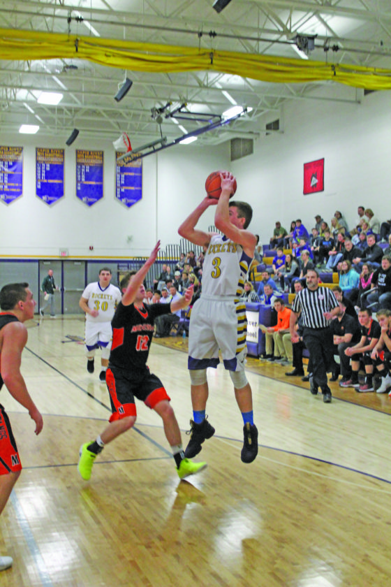 Avery Bundgaard | Daily Press  Rapid River's Lucas Sundling (3) puts up a shot over Munising's Cade Contreras (12) during the first half Tuesday at Rapid River.