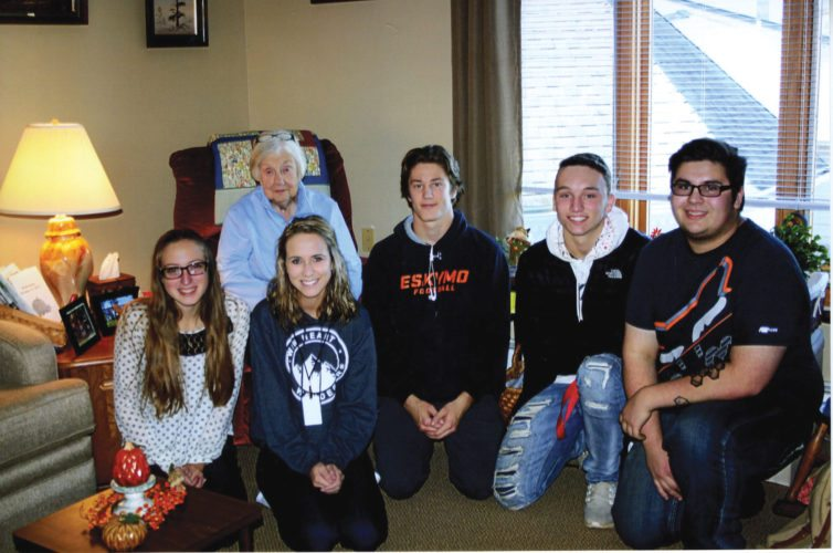 Courtesy photo   Escanaba High School seniors from English teacher Tammy Wiles' class spend time with a Northwoods Place Assisted Living home resident recently. The senior English students took part in a special project that allowed them to interview and create biographies about a local senior citizen. Students, shown from left with an unidentified Northwoods resident, are Kassie Holsten, Veronica Williams, Courage Krueger, Zach Lancour, and Walker Villeneuve.