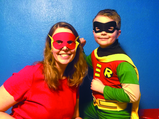 Bonifas Arts Center photo At right, Beth and Ty Peterson dress as superheroes.