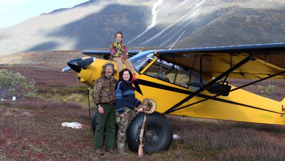 Courtesy photo Marty Meierotto and his family pose in front of his only way of getting to his trapline.