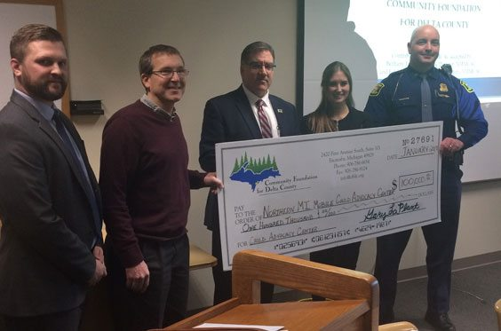 Courtesy photo Prosecuting Attorney Phil Strom, left, and Bethany Law, executive director of the Northern Michigan Mobile Child Advocacy Center, along with Michigan State Police 1st Lt. Josh Lator accept a check from the Community Foundation for Delta County Board Members Charles Becker (past board chair) and David Williams (current board chair).