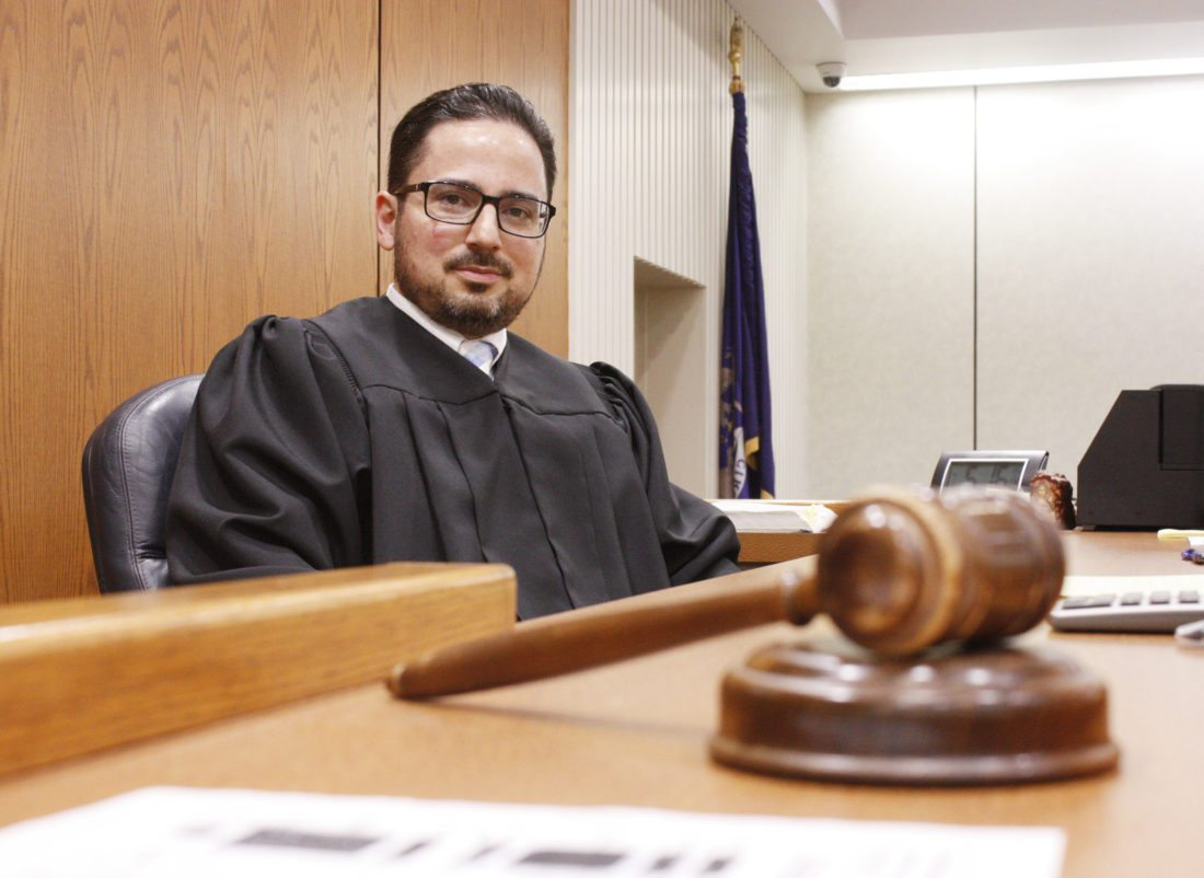 Jenny Lancour | Daily Press Delta County Judge John Economopoulos poses for a photograph in the 47th Judicial Circuit Court in Escanaba where he has served his first year presiding over a variety of criminal, family, and civil cases in 2017.