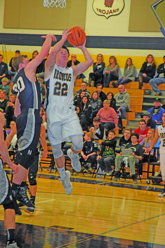 Mike Mattson | Daily Press Ryan Arndt (22) of Bark River-Harris soars for a layup as Norway's Kody Hendricks applies pressure in Friday night's game.