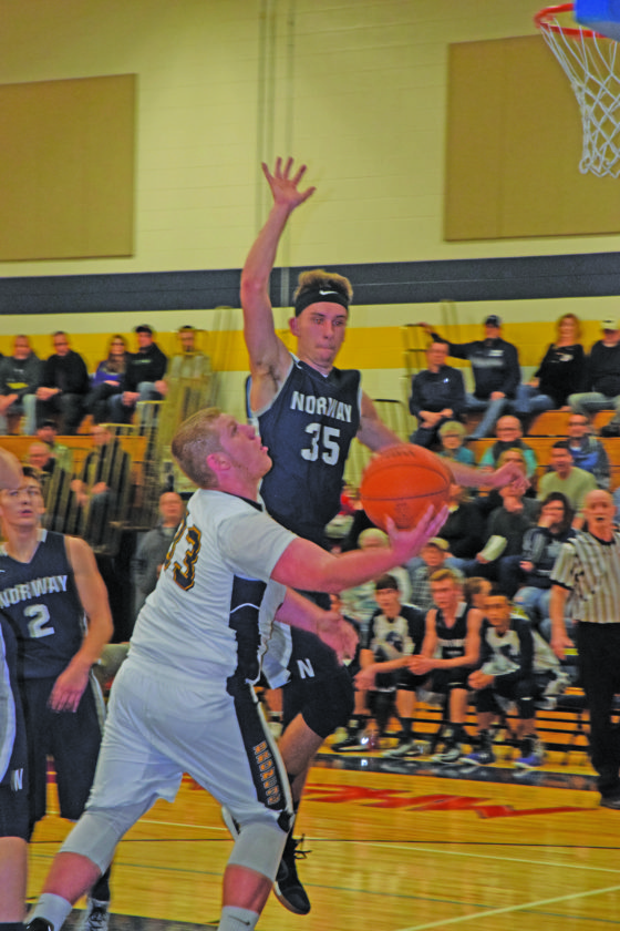 Mike Mattson | Daily Press Bark River-Harris' Bryson Groos (33) scoops a shot at the basket as Norway's Connor Ortman (35) attempts a block in Friday night's game.