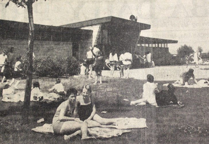 Daily Press photo The bath house at the municipal beach in Ludington Park was one of the most popular places in Escanaba, as thousands visited the beach daily to enjoy bathing in the summer of 1958. A chum, a beach towel, a bottle of suntan lotion and a youngster was fully equipped for an afternoon of fun.